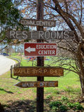 Multiple sign show the way to various locations. In a park Stock Photo