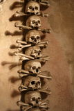 Multiple skulls formed into religious artwork Stock Photography