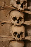 Multiple skulls formed into religious artwork Stock Images