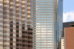 Multiple skyscrapers reflecting in the sun Stock Images