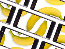Multiple smartphone screen. With a shared bananas photo Royalty Free Stock Image