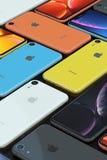 Arrangement of iPhone XR smarphones, all colours, vertical