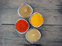 Multiple spices in bowl on wooden board. Multiple indian spices in bowl on wooden board stock photos