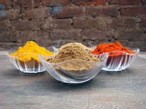 Multiple spices in crystal bowl. Multiple indian spices in crystal bowl stock photography