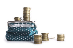 Multiple stacks of coins,Wallet with Royalty Free Stock Photos