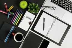 Office and School Stationery and Devices Supply. Multiple stationery items and devices for office and school. Top view royalty free stock image