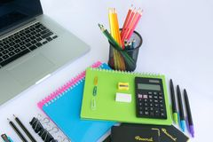 Office and Stationery Supplies and a Laptop. Multiple stationery items for office and school and a laptop Stock Photo