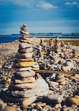 Multiple stone stacks. On the Lindisfarne coastline Stock Image