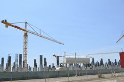 Multiple Tower Cranes and water tank Stock Image