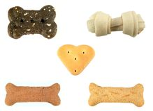 Multiple Treats. Close up of several dog treats in different shapes isolated on a white background Royalty Free Stock Photography