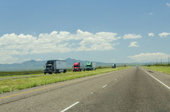 Multiple Truck Trailers Driving on Highway in New Mexico Royalty Free Stock Photography