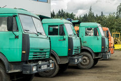 Multiple trucks park in a large parking lot. Royalty Free Stock Photos