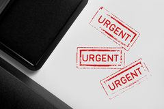 Urgent Stamps on White Background. Multiple Urgent stamps on white background Stock Image