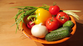 Multiple vegetables on a wooden plate stock footage