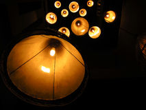Multiple warm lamps with light yellow. Multiple warm lamps with light yellow spots at night Stock Photography