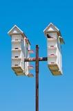 Multiple white bird houses Stock Photography