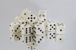 Multiple White dice with spots reflections Royalty Free Stock Images
