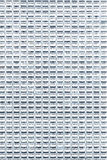Multiple windows on a hight office building Royalty Free Stock Photo