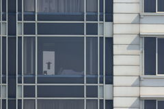 Multiple windows on a large office building Royalty Free Stock Photo