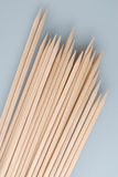Multiple wooden bamboo skewers laying Stock Photos