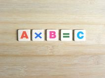 Multiplication in algebra. Multiplication concept in algebra AxB=C on wood background royalty free stock photography