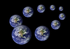Multiplied earth in the various sizes in black Stock Photography