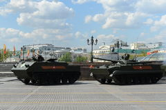 The multipurpose airborne armored personnel carrier BTR-MDM Rakushka and infantry fighting vehicle BMP-3. MOSCOW, RUSSIA - MAY 07, 2016: Rehearsal celebration royalty free stock photography