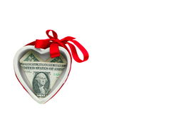 Multipurpose gift. Ceramic heart with a dollar bill inside, isolated on white Royalty Free Stock Photo