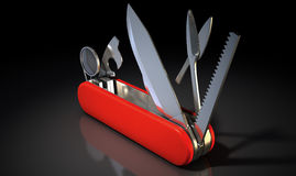 Multipurpose Penknife. A close up view of a multipurpose penknife with a blade and saw on an  studio background Royalty Free Stock Photos