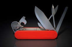 Multipurpose Penknife. A close up view of a multipurpose penknife with a blade and saw on an  studio background Royalty Free Stock Image