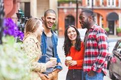 Multiracial группа в составе друзья имея потеху совместно в Лондоне Стоковое фото RF