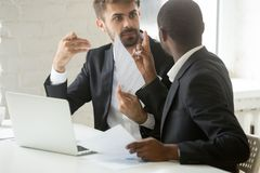 Multiracial african and caucasian partners arguing disagreeing a. Multiracial african and caucasian partners arguing about contract fraud, dissatisfied diverse Stock Photo