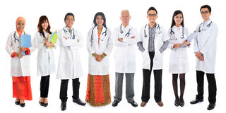 Multiracial Asian doctors. Multiracial diversity Asian doctors, medical team standing isolated on white background stock photo