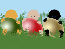 Multiracial babies with easter eggs Stock Image