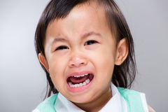 Multiracial baby girl cry. With gray background Royalty Free Stock Photography