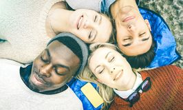 Multiracial best friends having fun resting together. Top view of multiracial best friends having fun resting together outdoors on sunny day - Happy friendship Royalty Free Stock Images
