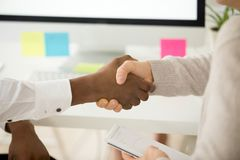 Multiracial business handshake as concept of help support in tea. Multiracial business handshake as concept of successful teamwork, african american and royalty free stock photo