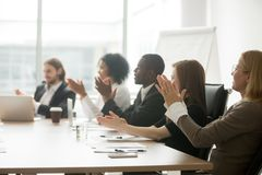 Multiracial business people applauding clapping hands at confere royalty free stock photography