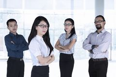 Multiracial business team with arms crossed Stock Images