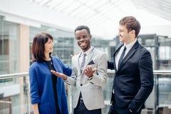 Multiracial Business Team congratulate For Success Of afroamerican Colleague. Multiracial Business Team congratulate For The Success Of afroamerican Colleague Stock Photos