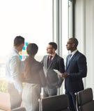 Multiracial business team having a meeting Royalty Free Stock Photos