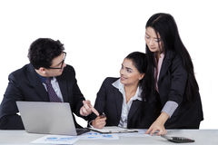 Multiracial business team talking in office Royalty Free Stock Image