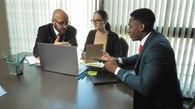 Multiracial businessmen discuss new projects in slow motion
