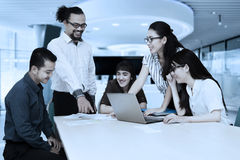 Multiracial businesspeople discussing together Royalty Free Stock Image