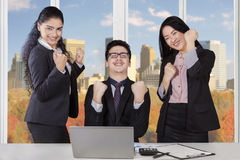 Multiracial businesspeople expressing success in office Royalty Free Stock Photos