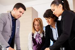 Multiracial businesspeople having conversation in conference hall. royalty free stock photos