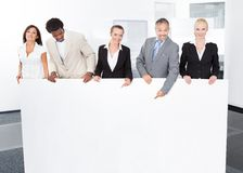 Multiracial Businesspeople Holding Placard Stock Images