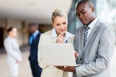 Multiracial businesspeople laptop computer Stock Photos