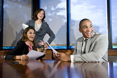 Multiracial businesspeople watching presentation Stock Photo