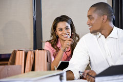 Multiracial businesspeople working on documents Stock Photo